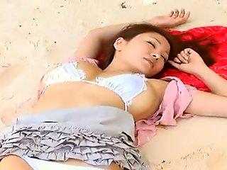 Busty Japanese angel Yoko Matsugane sensually touches her huge boobies